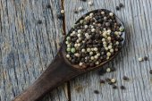 Peppercorn on a wooden Spoon — Stock Photo