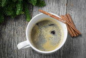 Coffee and Cinnamon for the Holidays with Christmas Pine Branch — Stock Photo