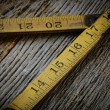 Old Tape Measure on Rustic Wood Background — Stock Photo #60883755