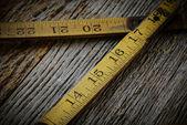 Old Tape Measure on Rustic Wood Background — Foto de Stock
