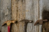 Old Hammers on Rustic Wood Background — Stock Photo