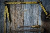 Old Tape Measure and Screwdriver for Construction on Rustic Wood — Photo