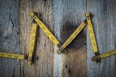 Old Tape Measure on Rustic Wood Background — Stock Photo