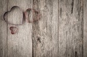 Hearts on Rustic Wooden Background — Stock Photo