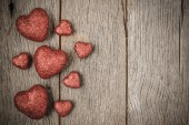 Hearts on Vintage Wood Background for Valentine's Day — Stock Photo