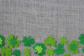 Green Clovers on Burlap Background — Stock Photo
