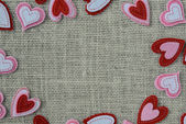 Red Hearts Frame or Border on Burlap Background — Stock Photo