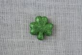 Green Clover on Burlap Background — Stock Photo