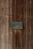 Old Wooden Door with Blank Metal Plate — Stock Photo