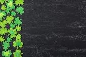 Green Clovers on Chalkboard — Stock Photo