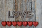 Hearts and text on Wooden Background — Stock Photo