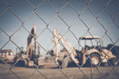 Excavator in vintage film style — Stock Photo
