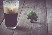 Pint of Stout Beer with Green Shamrock — Stock Photo