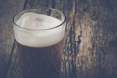 Pint of Pilsner Beer on Wood Background — Stock Photo