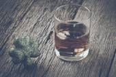 Glass of Whiskey and Clover — Stock Photo