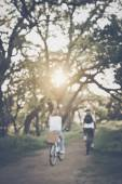 Blurred Young Couple Riding Bicycles — Stockfoto