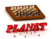 PLANET- inscription of color letters and chess on — Stock Photo