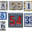 Collection of House numbers on the wall — Stock Photo #54465893