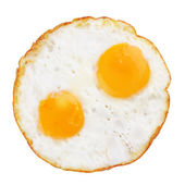Fried eggs on white — Stock Photo