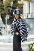 Model posing in fur coat and fur hat — Stock Photo