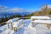 Snow on table and seats — Stockfoto