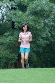 Sport fitness woman running in park — Stock Photo