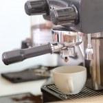 Coffee machine making espresso in a cafe — Stock Photo #64610335