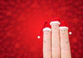 Visages de doigts en chapeaux santa — Photo