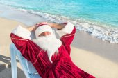 Santa Claus have a rest in lounge on sea beach — Foto Stock