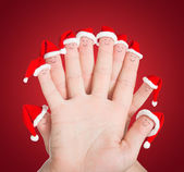 Fingers faces in Santa hats — Stock Photo