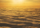 Golden sunset sky above clouds — Stock Photo