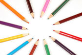 Colorful wooden pencils in circle — Stock Photo