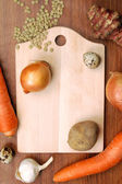 Cutting board with vegetables — Stock Photo