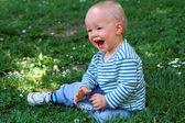 Happy baby boy in grass — Stock Photo
