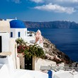 GREECE, SANTORINI- OCT 3: The greek church in the Oia village, sea view. October 3, 2014 — Stock Photo #59093495