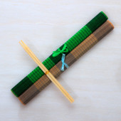 Two chopsticks on bamboo mats — Stock Photo