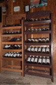 European traditional shelves with wine bottles — Foto de Stock