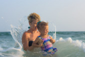 Mother and daughter swimming together  — Stock Photo