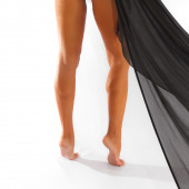 Female legs wrapped in silky cloth  — Stock Photo