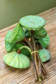 Lotus pods on rattan table — Stock Photo