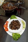 Pork liver stewed with onions and carrot and red beans — Stock Photo