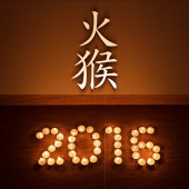 Chinese new year greeting card with evening tea light candles in form of 2016 — Stock Photo