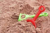 Children's beach toys on sand — Stock Photo