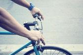 Hand with bike — Stock Photo