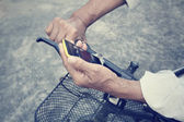 Man using smartphone with bicycle — Stock Photo