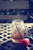 Strawberry drink with red rose — Stock fotografie