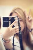 Woman using a camera to take photo — Stock Photo