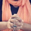 Woman hands praying with cross — Stock Photo #63209479
