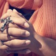 Woman hands praying with cross — Stock Photo #63209615