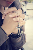 Hands praying with cross — Stock Photo
